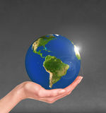 Planet earth in a human hand Royalty Free Stock Image