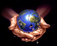 Planet earth on human hands, breaking down. Stock Photos