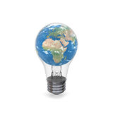 Planet Earth inside lightbulb Stock Image