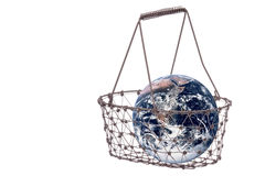Planet Earth in Iron Basket Isolated. Isolated image planet earth in an iron basket Stock Photos