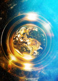 Planet earth in light circle with light triangle structure. Computer collage. Earth concept. Planet earth in light rays Stock Photos