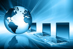Planet earth and light. Laptops. Best Internet Concept of global business from concepts series Royalty Free Stock Images
