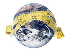 Planet Earth Measuring Tape Isolated. Isolated macro image of planet earth with a measuring tape Royalty Free Stock Photography