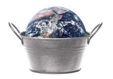 Planet Earth with Metal Pail Isolated stock photo