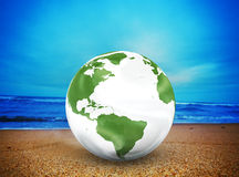 Planet earth model on the beach Royalty Free Stock Image