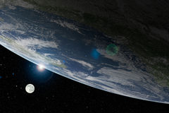Planet Earth and moon from above with lens flare Royalty Free Stock Photo
