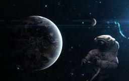 Planet Earth and the Moon. Astronaut, space landscape. Science fiction art. Elements of the image were furnished by NASA. Planet Earth and the Moon. Astronaut royalty free stock image
