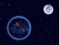 Planet earth and moon on night sky. Europe, Africa. Elements of this image furnished by NASA Stock Photos