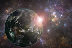 Planet Earth with night city lights and rising sun. Elements of this image furnished by NASA royalty free illustration