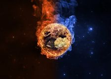Planet Earth in orange and blue flames. Global warming concept.Elements of this image furnished by NASA Royalty Free Stock Images