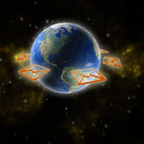 Planet Earth with orange email Royalty Free Stock Image
