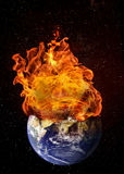 Planet Earth in Outer Space Engulfed in Flames. Concept of natural disasters, global warming, apocalypse, war, judgment day. Elements of this image used with Stock Photos