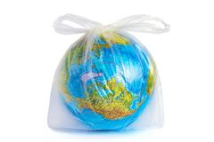 Planet Earth in polyethylene plastic disposable bag. Model planet Earth globe in polyethylene plastic disposable package, on white background. Сoncept pollution stock photos