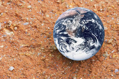 Planet Earth on Red Earth. Image of planet earth on red earth Stock Photography