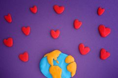 Planet Earth with red hearts stock photo