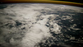 Planet Earth seen through the porthole of the ISS. Elements of this video furnished by NASA stock footage
