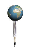 Planet earth in a silver microphone Stock Photography