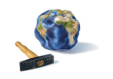 Planet earth smashed by a hammer. Royalty Free Stock Photography