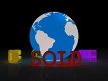 Planet Earth with sold sign Royalty Free Stock Image