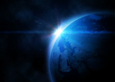 Planet earth in space. Planet earth with shiny sunrise in black space Stock Images