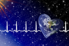 Planet Earth in Space. Heart shaped planet with heartbeats and reflection in water Royalty Free Stock Image