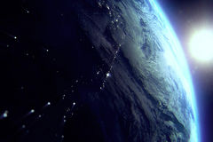 Planet earth from the space at night with sun near. On black background Royalty Free Stock Photo