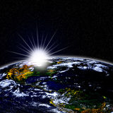Rising Sun and Planet Earth royalty free stock photo