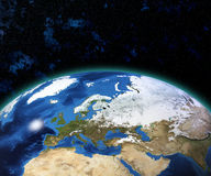 Planet Earth with sun rising over European countries Royalty Free Stock Images