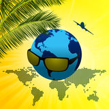 Planet Earth with sunglasses on summer background Stock Photos