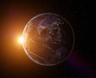 Planet Earth sunrise. Planet Earth with rising Sun, view from space. Elements of this image furnished by NASA Stock Photo