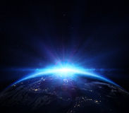 Planet earth with sunrise in the space royalty free illustration