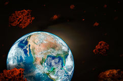 Planet Earth surrounded by meteorites Stock Image