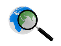 Planet the earth under magnifying glass Stock Image