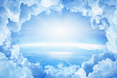 Planet Earth in white clouds royalty free stock image
