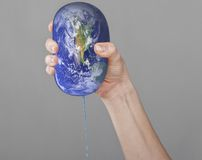 The planet Earth in a woman hands. Royalty Free Stock Photography