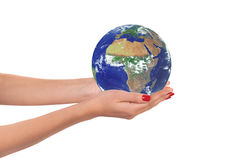 The planet Earth in a woman hands. Stock Photos