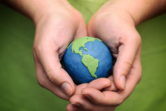 Planet Earth in the woman's hands Stock Photography