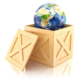 Planet Earth in a wooden box. Stock Photo