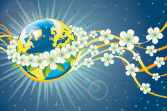 Planet earth in wreath of spring flowers and ribbo Stock Image
