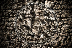Planet with fragment of natural stone wall. Collage. Toned Stock Image