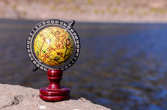 Planet Globe Earth. On the Rock near the Water Royalty Free Stock Photos