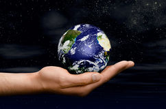 Planet on a hand Stock Images