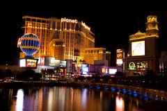Planet Hollywood Casinos reflecting in the Bellagio fountain lake Stock Photography