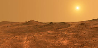 Planet Mars - elements of this image furnished by NASA. Surface of the Mars with sun in the background Royalty Free Stock Photo
