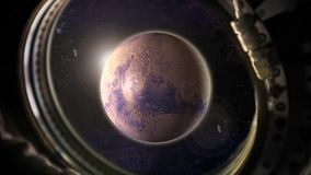 Planet Mars in space with sunlight view from the window of the spacecraft. Close-up royalty free stock photos