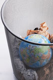 Planet In a Paper Dustbin. Planet Trashed In a Paper Dustbin Stock Image