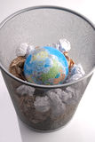 Planet In a Paper Dustbin Stock Photos