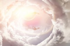 Planet pierces through the clouds Royalty Free Stock Photo
