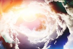 Planet pierces through the clouds Royalty Free Stock Images