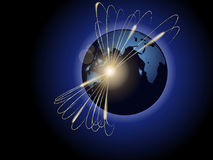 Planet in the rays. Sparkling rays emerging from the planet on the dark background of space Royalty Free Stock Image